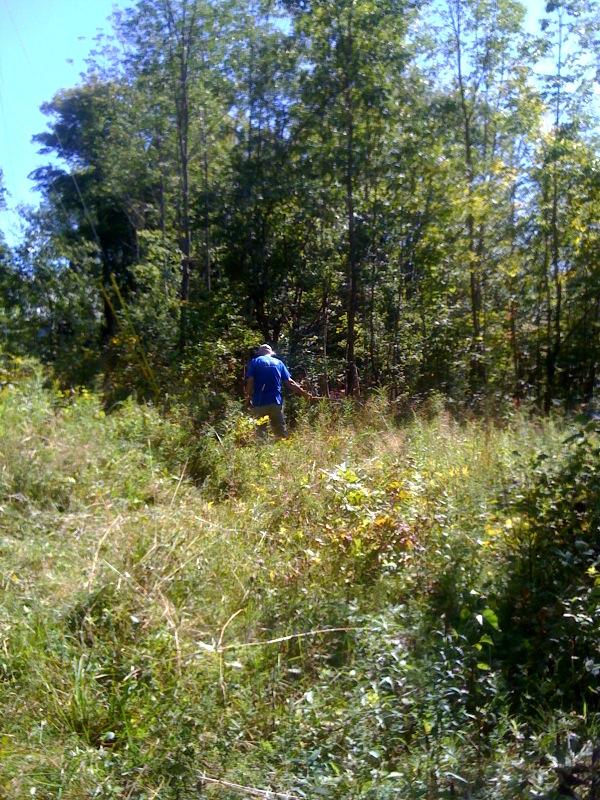 Friend John whipping grass into shape!