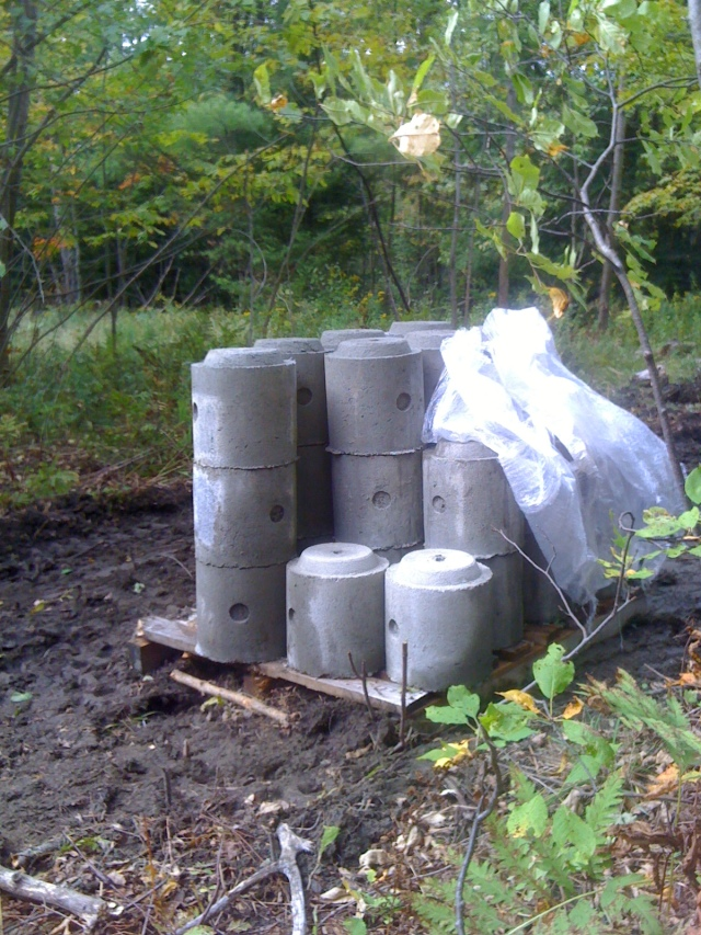 A pallet full of pre-cast sections of EZ-Tube posts