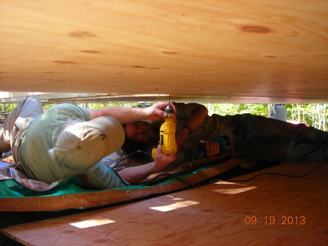 John and Peter closing in floor under house made for some cozy work conditions!