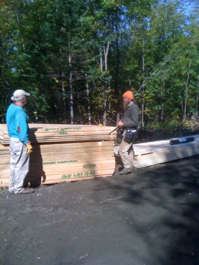 Peter laying out the flooring plan with John